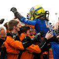 Lando Norris celebrates with McLaren team-mates after finishing third at Imola