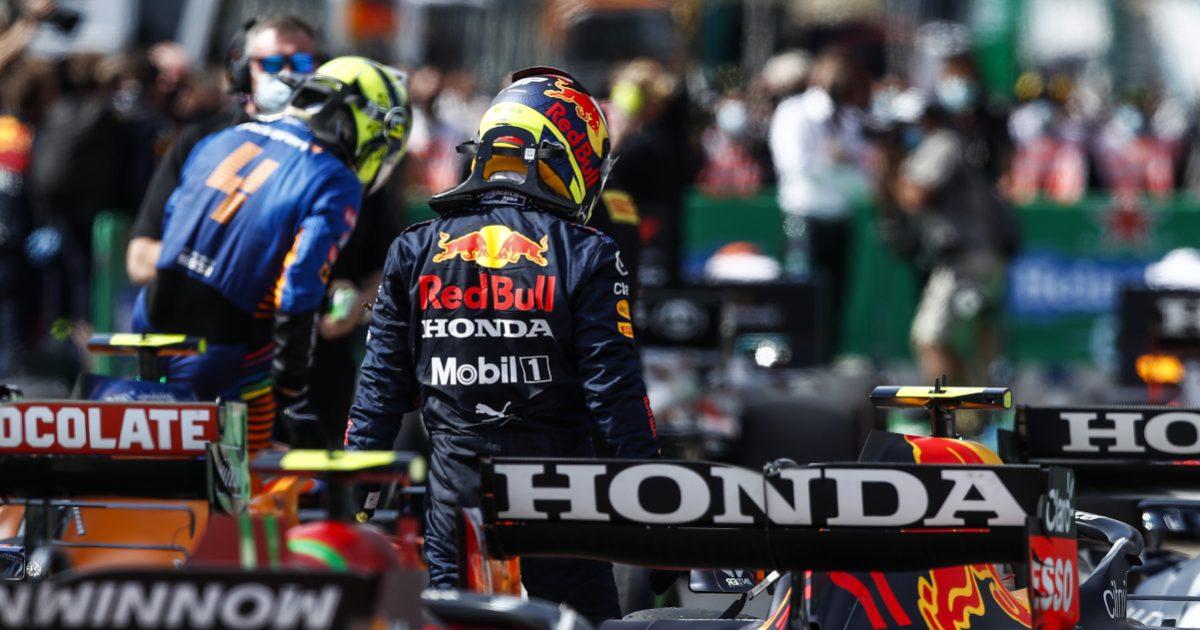 Sergio Perez with Lando Norris in the background