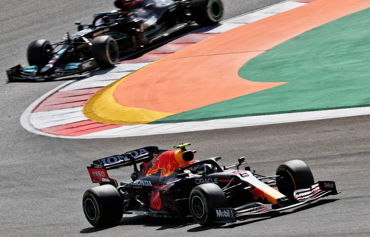 Sergio Perez, Red Bull, ahead of a Mercedes