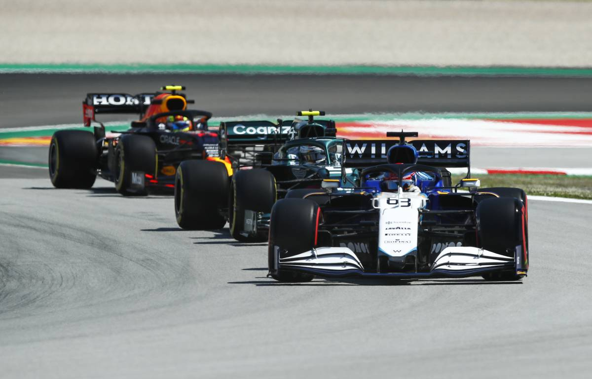 George Russell, Williams, ahead of Aston Martin and Red Bull