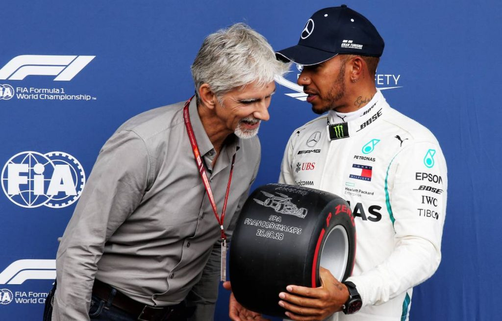 Lewis Hamilton receives the Pole Position Award from Damon Hill at the 2018 Belgian Grand Prix