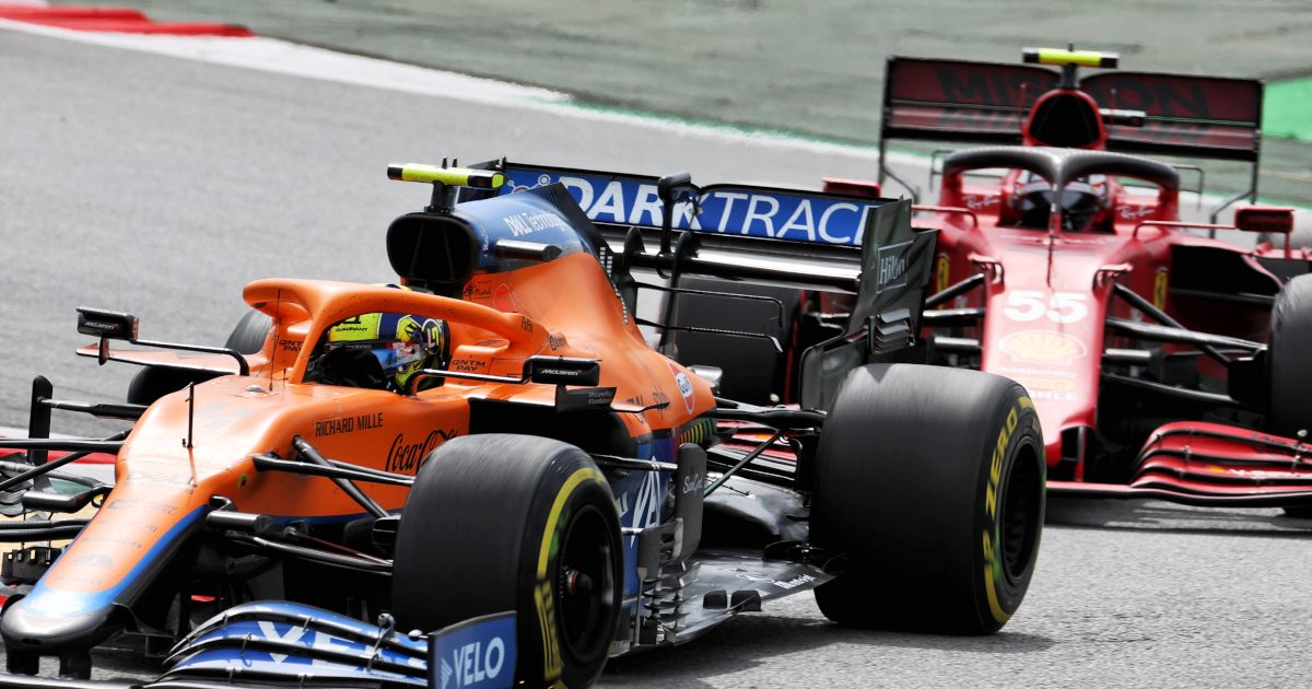 Lando Norris chased by Carlos Sainz