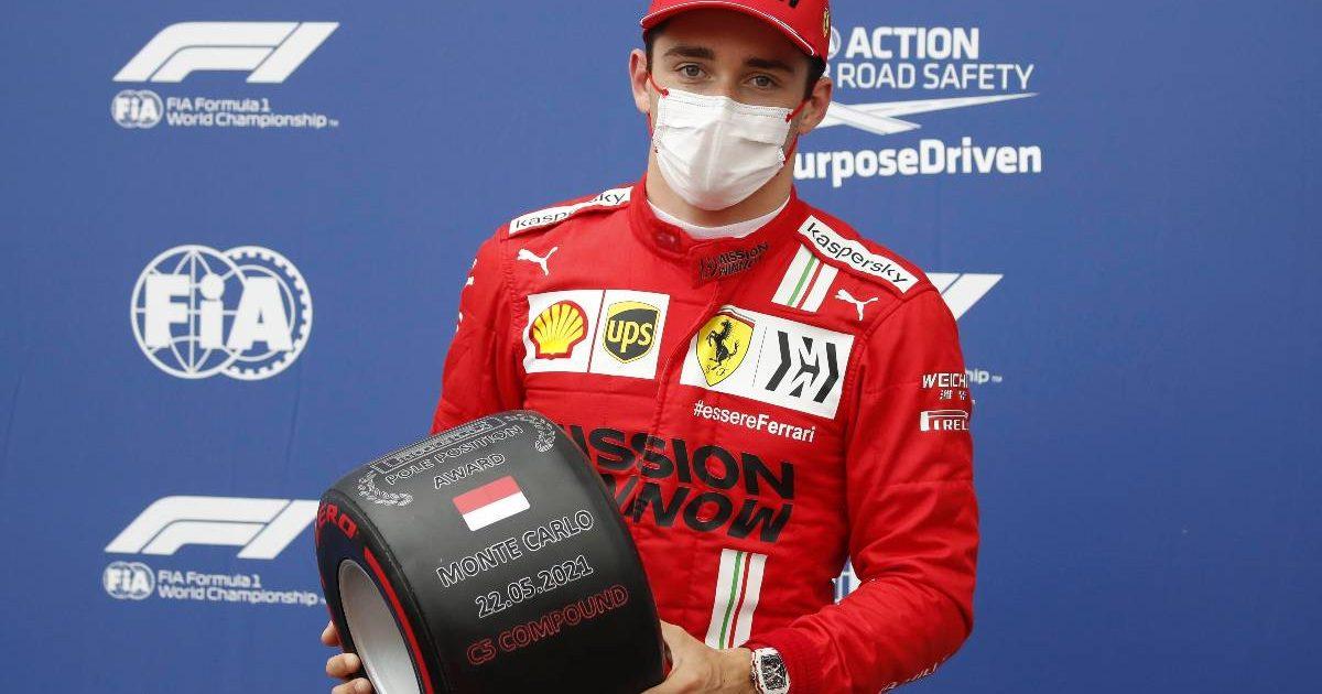 Ferrari's Charles Leclerc with the pole position prize at the 2021 Monaco Grand Prix
