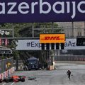 Max Verstappen runs away from his crashed Red Bull during the 2021 Azerbaijan Grand Prix