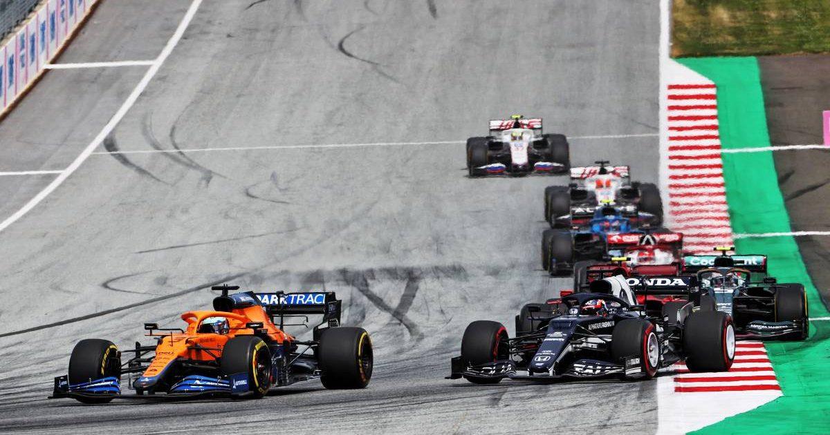 Daniel Ricciardo, McLaren, challenged by Yuki Tsunoda's AlphaTauri