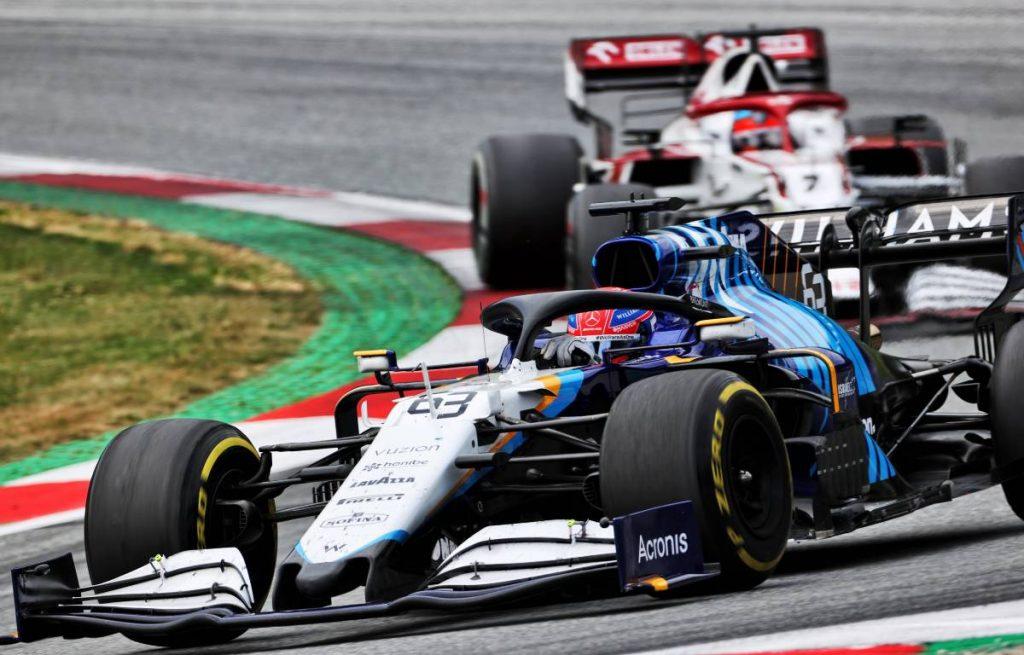 George Russell, Williams, with Kimi Raikkonen, Alfa Romeo, behind