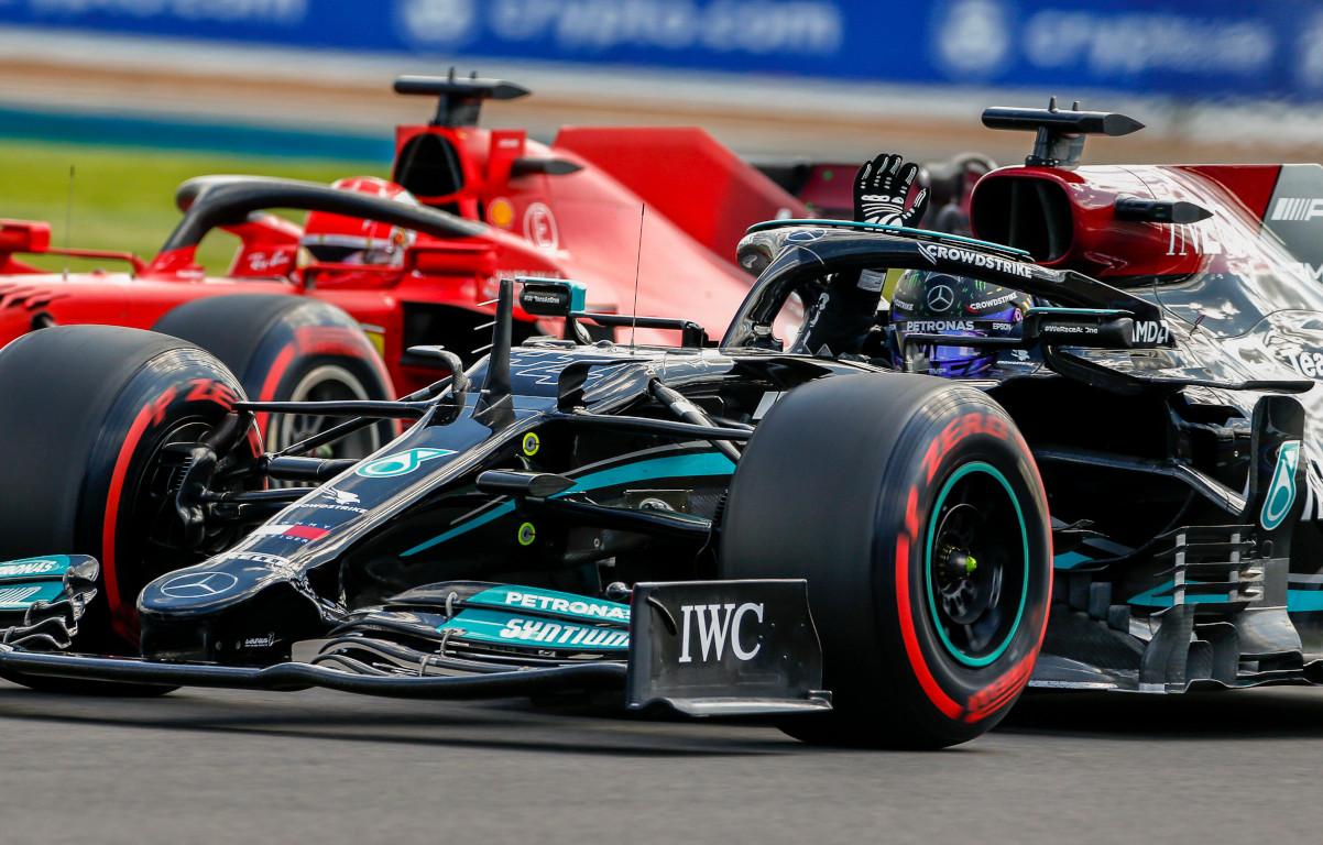 Lewis Hamilton waves Ferrari