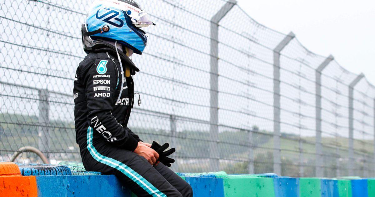 Valtteri Bottas sitting on a wall