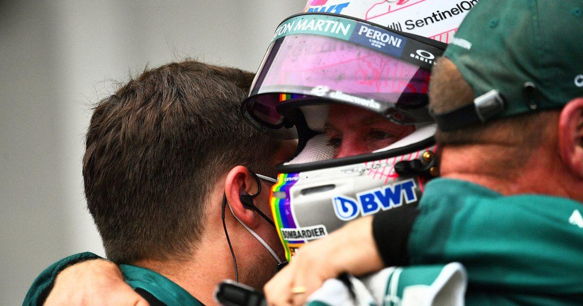 Sebastian Vettel hugs Aston Martin