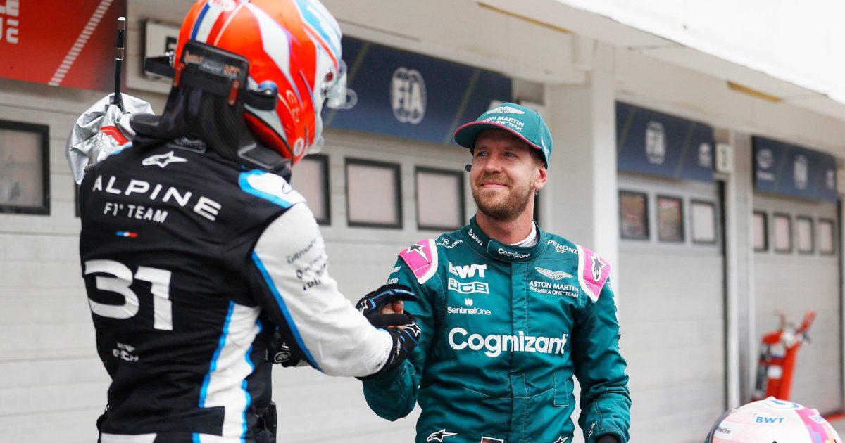 Esteban Ocon and Sebastian Vettel