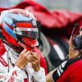 Alfa Romeo driver Kimi Raikkonen putting on his helmet. Hungary August 2021.