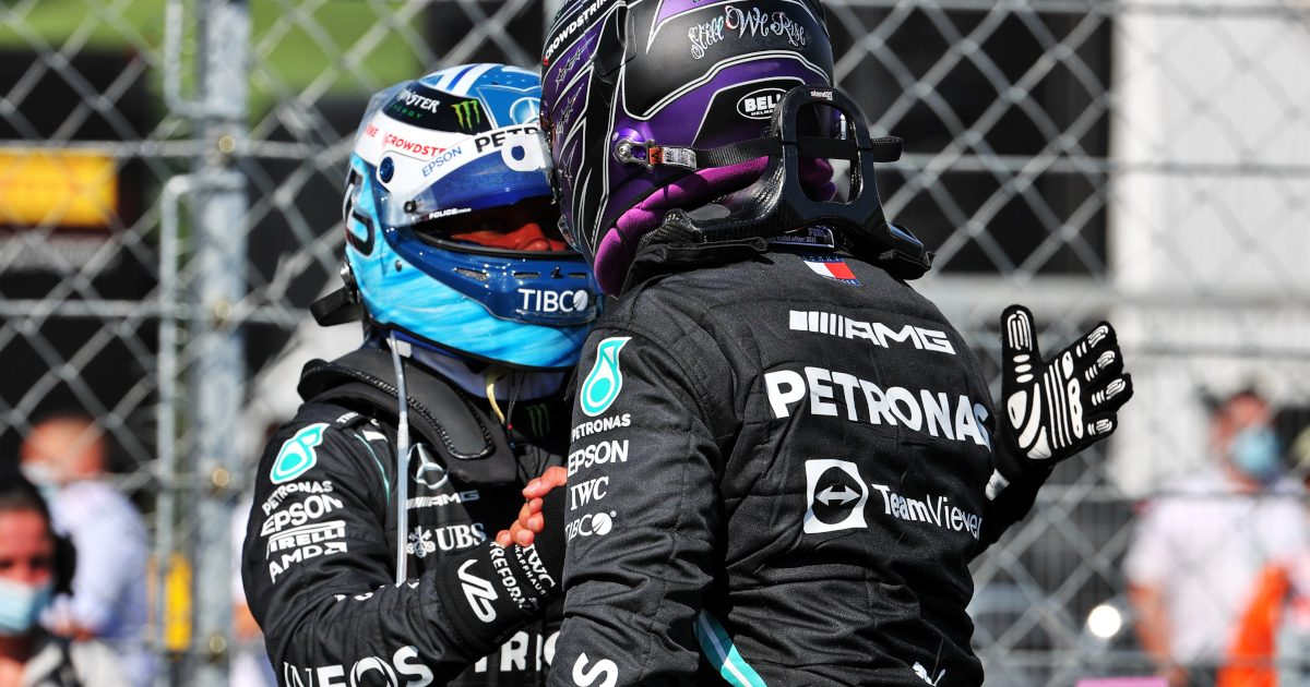 Lewis Hamilton and Valtteri Bottas shake hands. Hungary August 2021