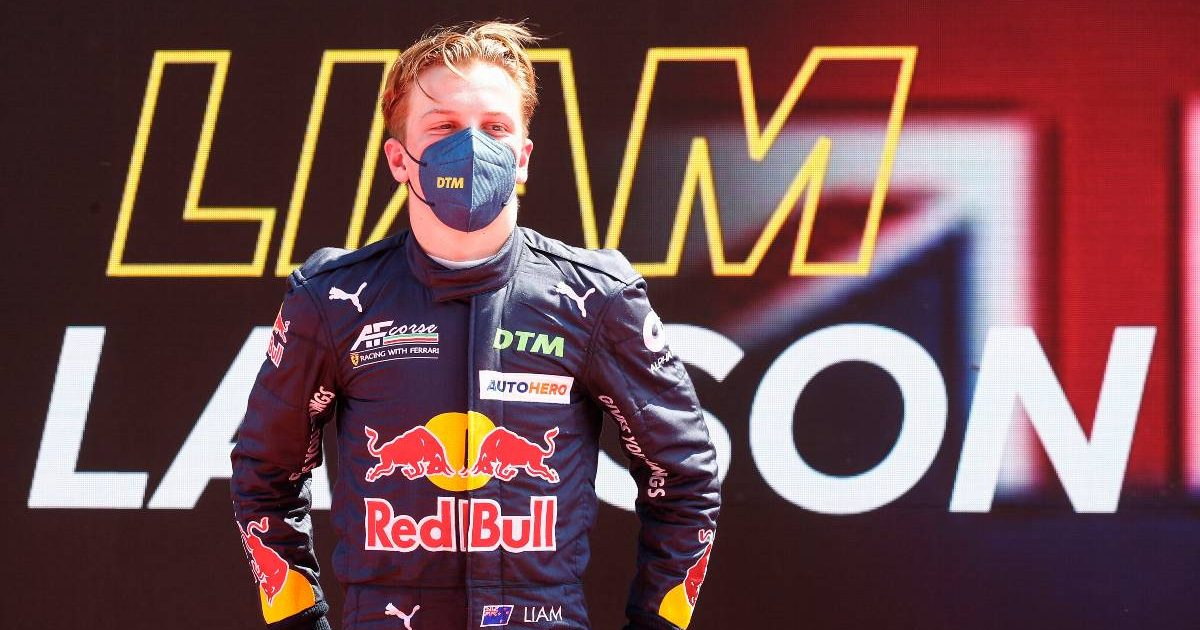 Liam Lawson wearing Red Bull inspired DTM race suit. July 2021.