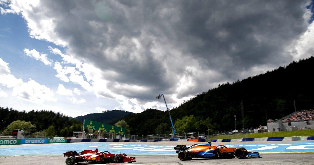 Charles Leclerc and Daniel Ricciardo battle.