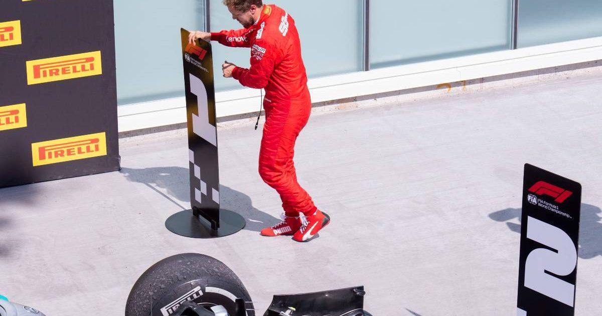Sebastian Vettel swaps the marker boards after the Canadian Grand Prix. Montreal June 2019.