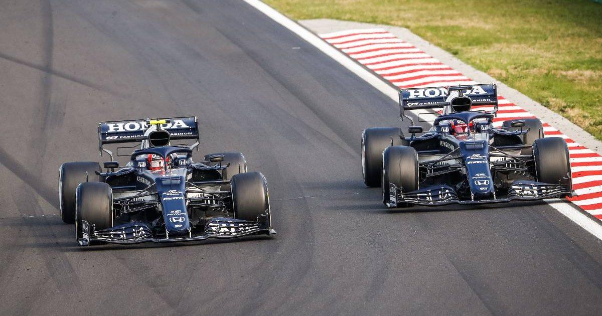 Pierre Gasly passes Yuki Tsunoda in the 2021 Hungarian Grand Prix. Hungaroring 2021.