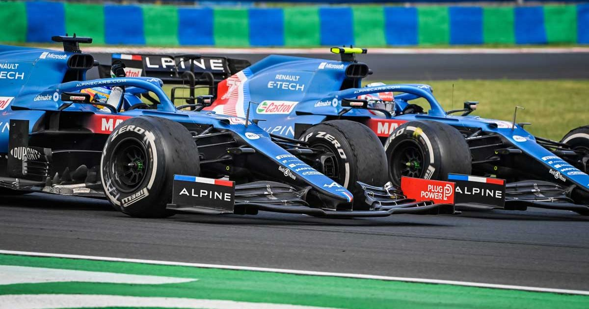 Esteban Ocon and Fernando Alonso of Alpine Renault run alongside each other, Hungarian GP, August 2021.