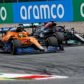 Lando Norris and Lewis Hamilton compete in the Austrian GP, July 2021.