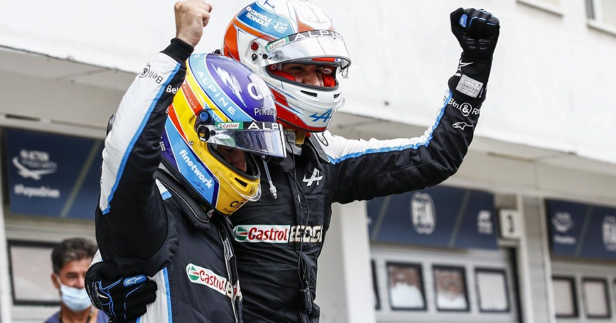 Fernando Alonso and Esteban Ocon celebrate the Frenchman's win in Hungary. August 2021.