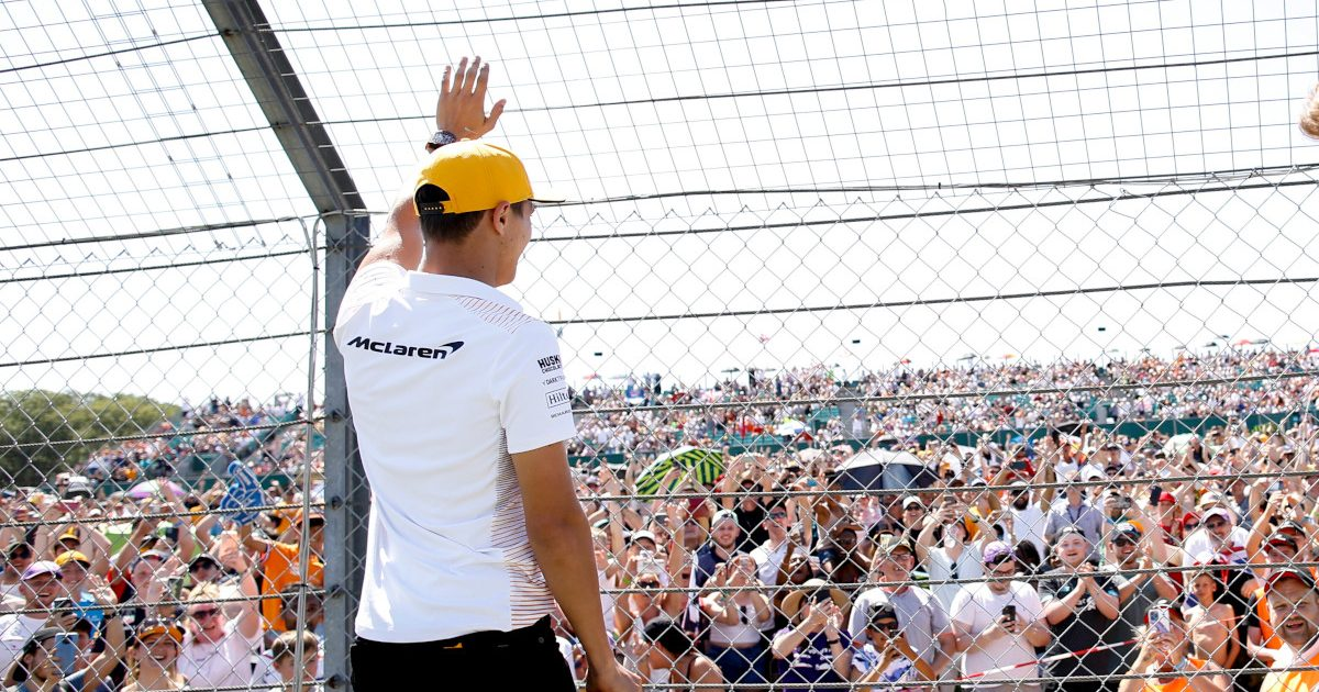 Lando Norris waves to the crowd at the British Grand Prix. Silverstone July 2021