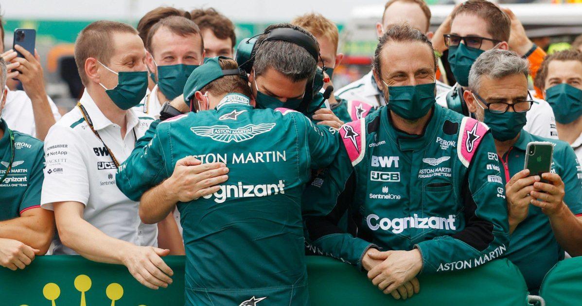 Sebastian Vettel hugs his Aston Martin team. Hungary August 2021