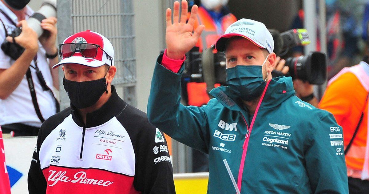 Kimi Raikkonen walking with Sebastian Vettel. Austria July 2021.