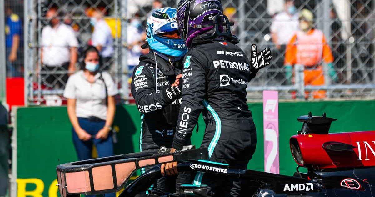 Valtteri Bottas and Lewis Hamilton shake hands at the Hungarian GP. August 2021.
