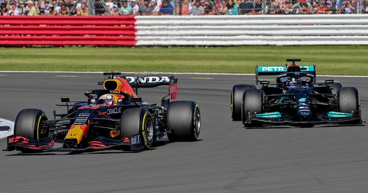 Mercedes' Lewis Hamilton looks to pass Red Bull driver Max Verstappen at Silverstone. July, 2021.