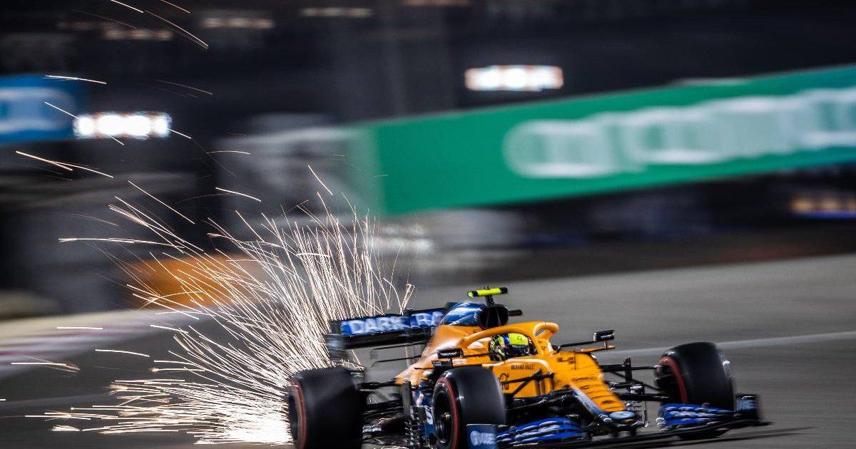 Sparks fly from Lando Norris' McLaren at the Bahrain GP. Sakhir March 2021.