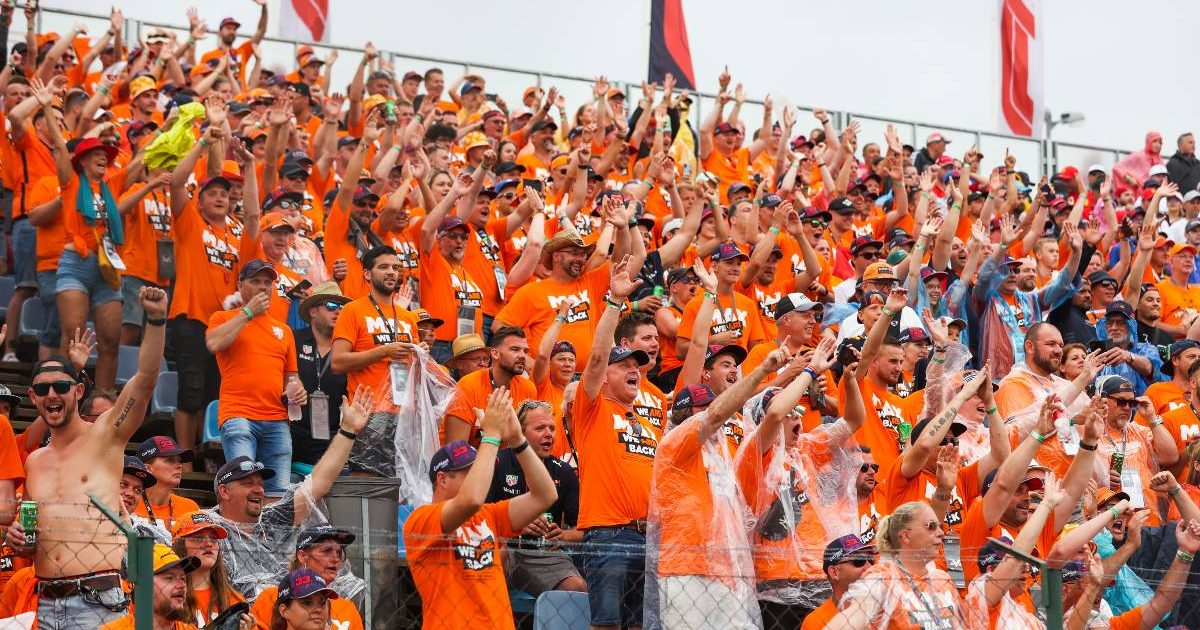 Dutch fans cheer on Max Verstappen at the Hungarian GP. Hungaroring August 2021.