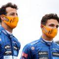 McLaren's Daniel Ricciardo and Lando Norris speaking at the British Grand Prix. July, 2021.