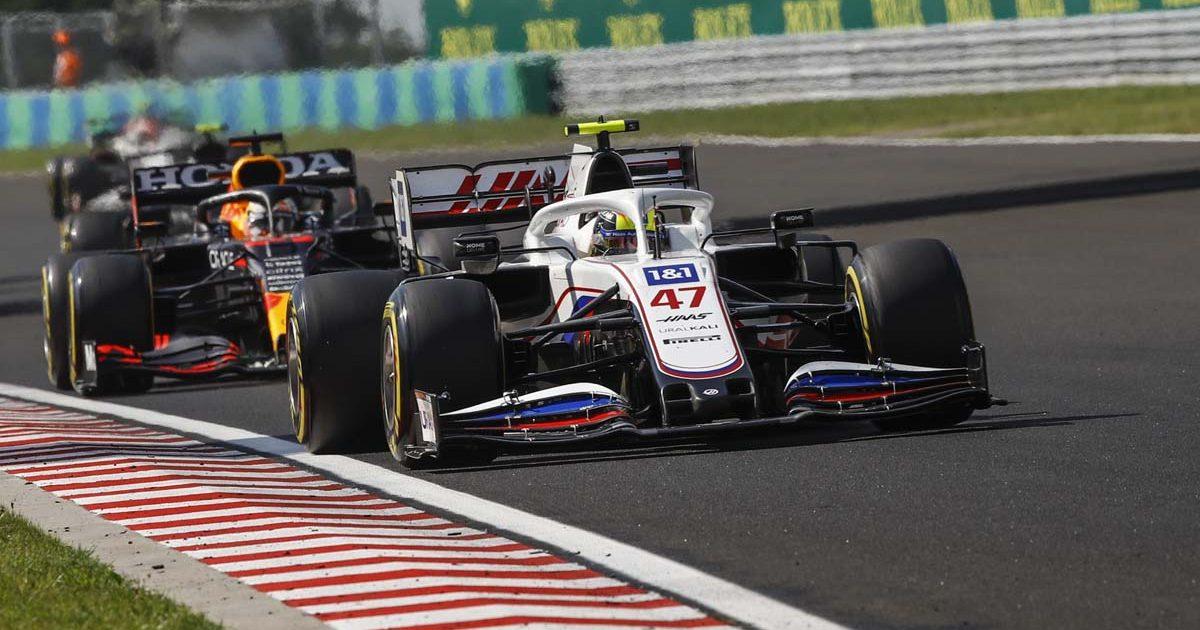 Haas driver Mick Schumacher leads Max Verstappen