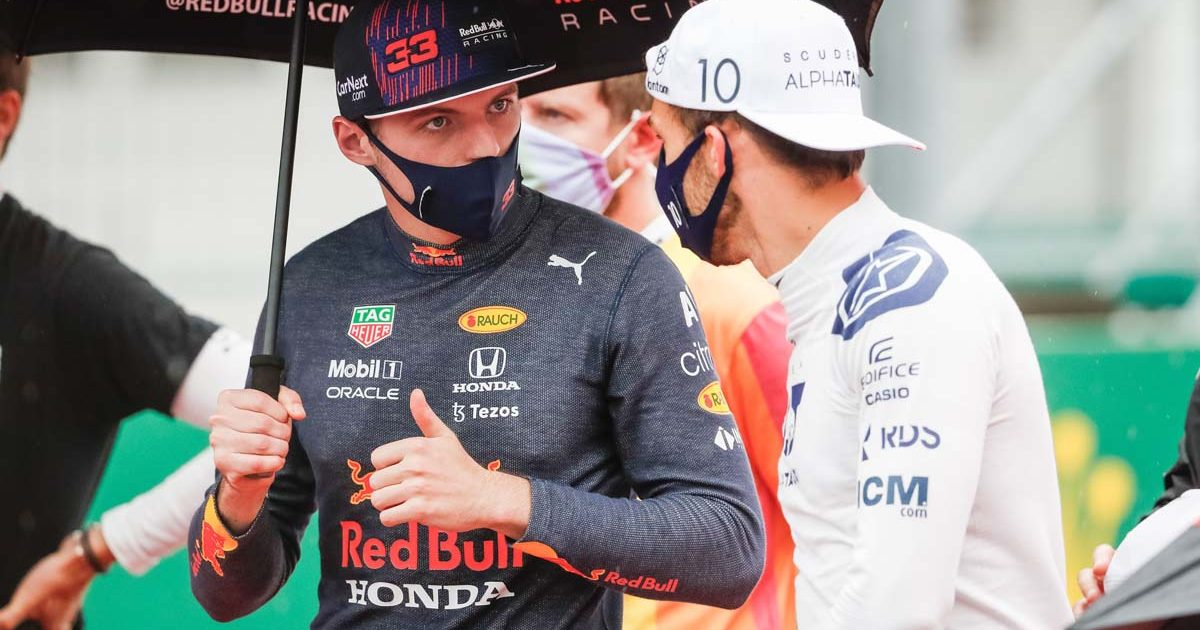Max Verstappen and Pierre Gasly speak on the grid