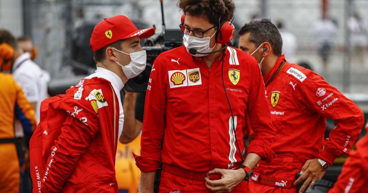 Ferrari team boss Mattia Binotto and Charles Leclerc speak on the grid.