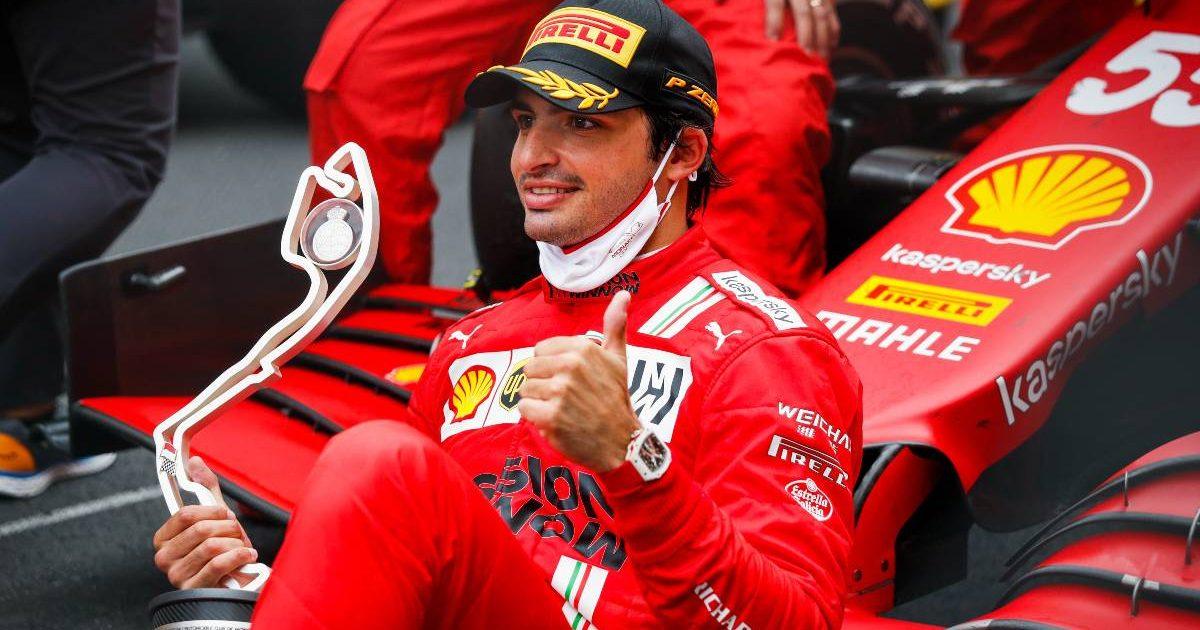 Ferrari's Carlos Sainz poses with his Monaco P2 trophy. May, 2021.