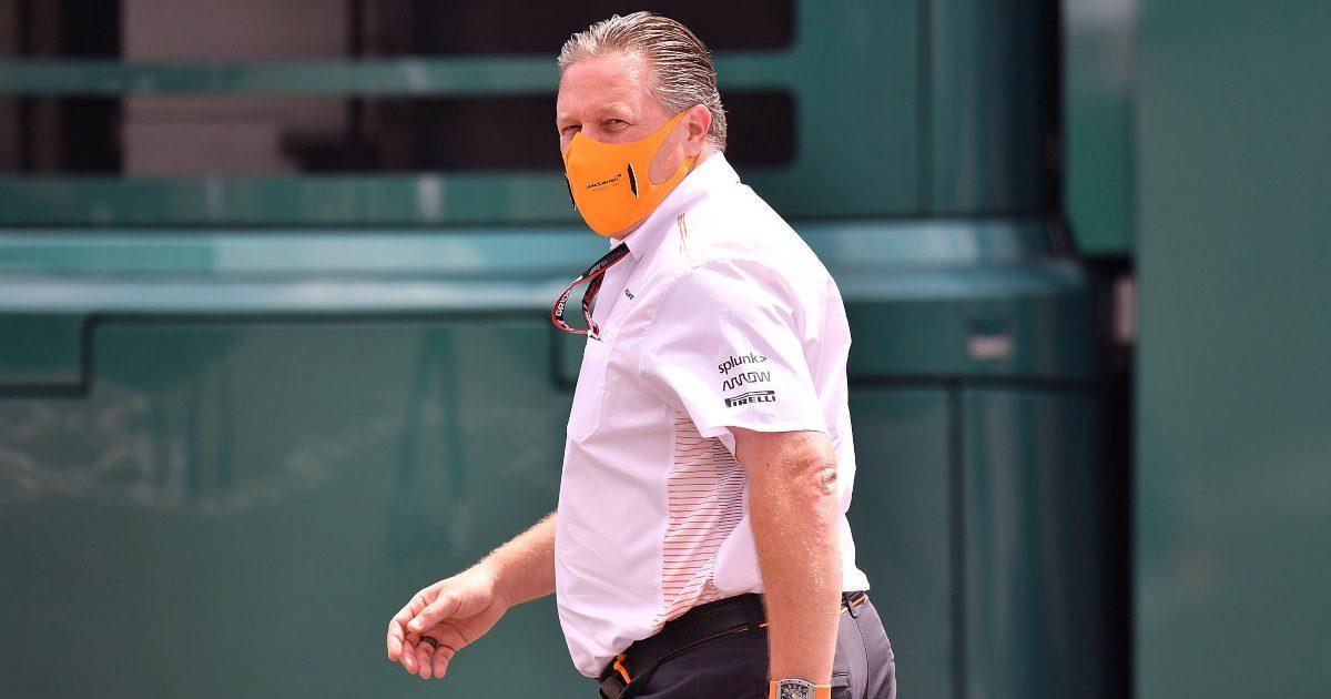 McLaren CEO Zak Brown walks through the paddock.
