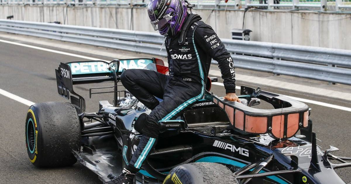 Lewis Hamilton exits the cockpit of his Mercedes W12. Hungary, August 2021.