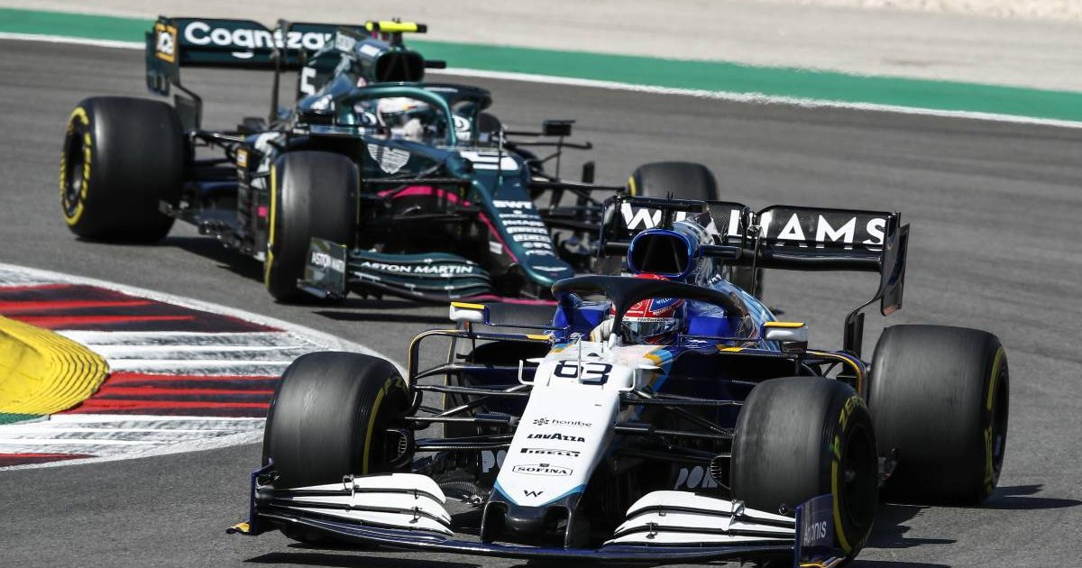 George Russell ahead of Sebastian Vettel during the Portuguese GP. Portimao May 2021.