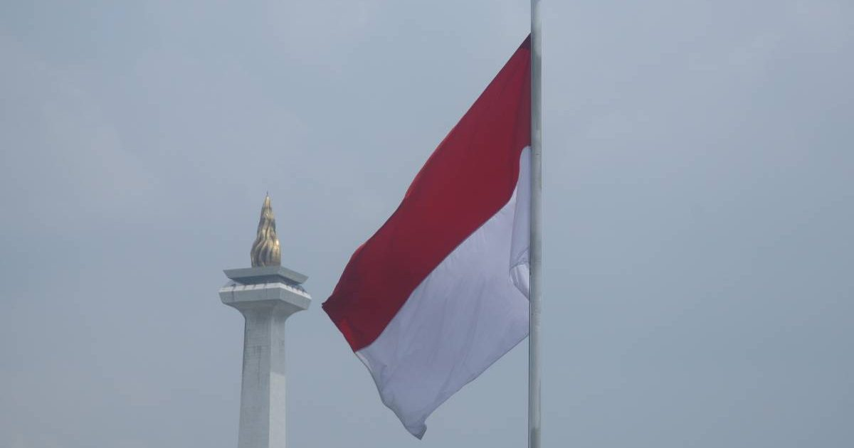 Indonesian flag in Jakarta next to the National Monument