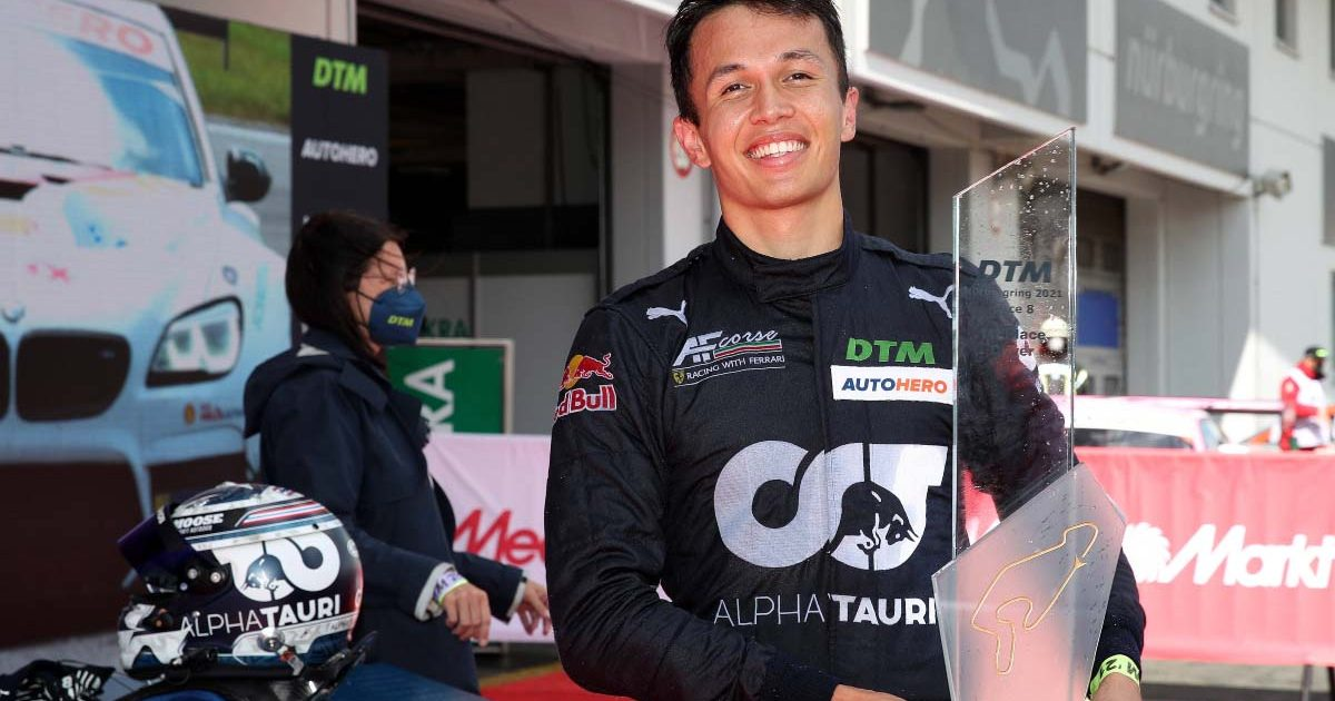 Alex Albon holds a first-place trophy at a DTM race. Nurburgring August 2021.