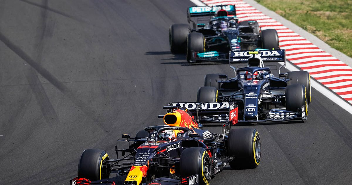 Pierre Gasly between a Red Bull and Mercedes at the Hungarian Grand Prix. Budapest August 2021