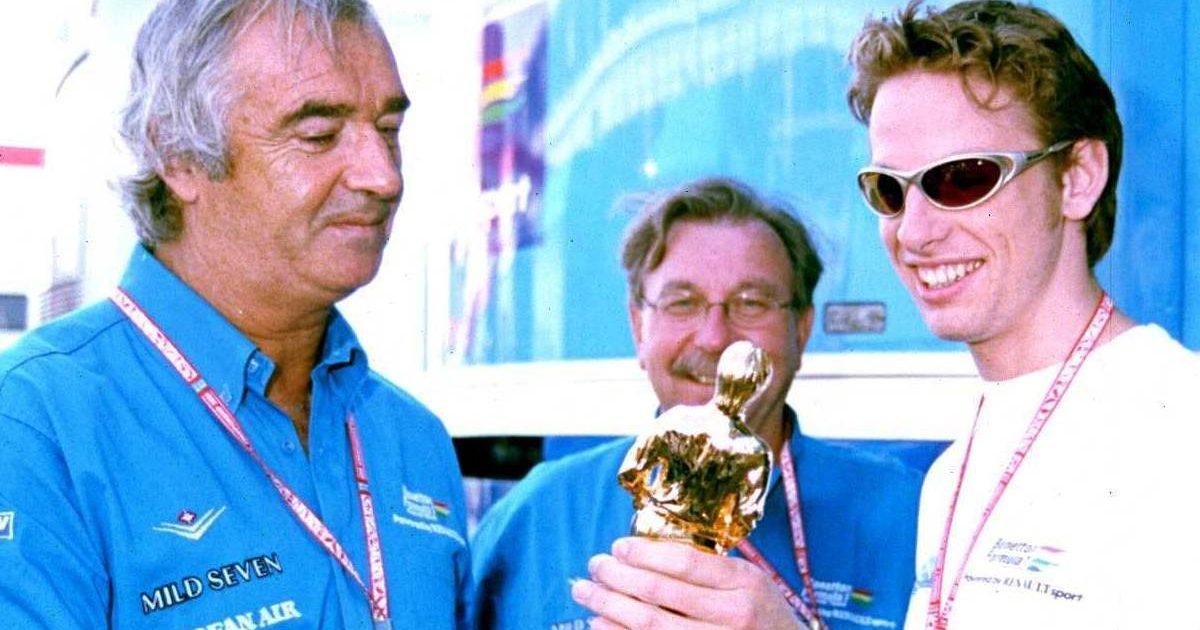 """Jenson Button shows his """"Bernie"""" Best Newcomer Award to Flavio Briatore. 2001."""