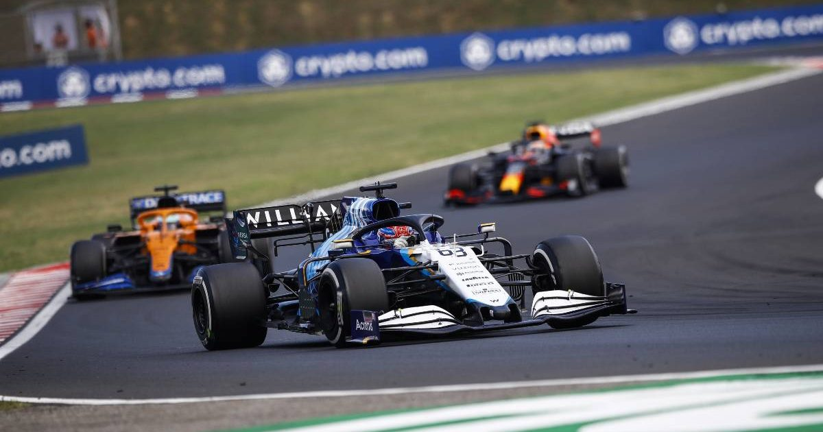 George Russell ahead of a McLaren and a Red Bull during the Hungarian GP. Hungaroring August 2021.