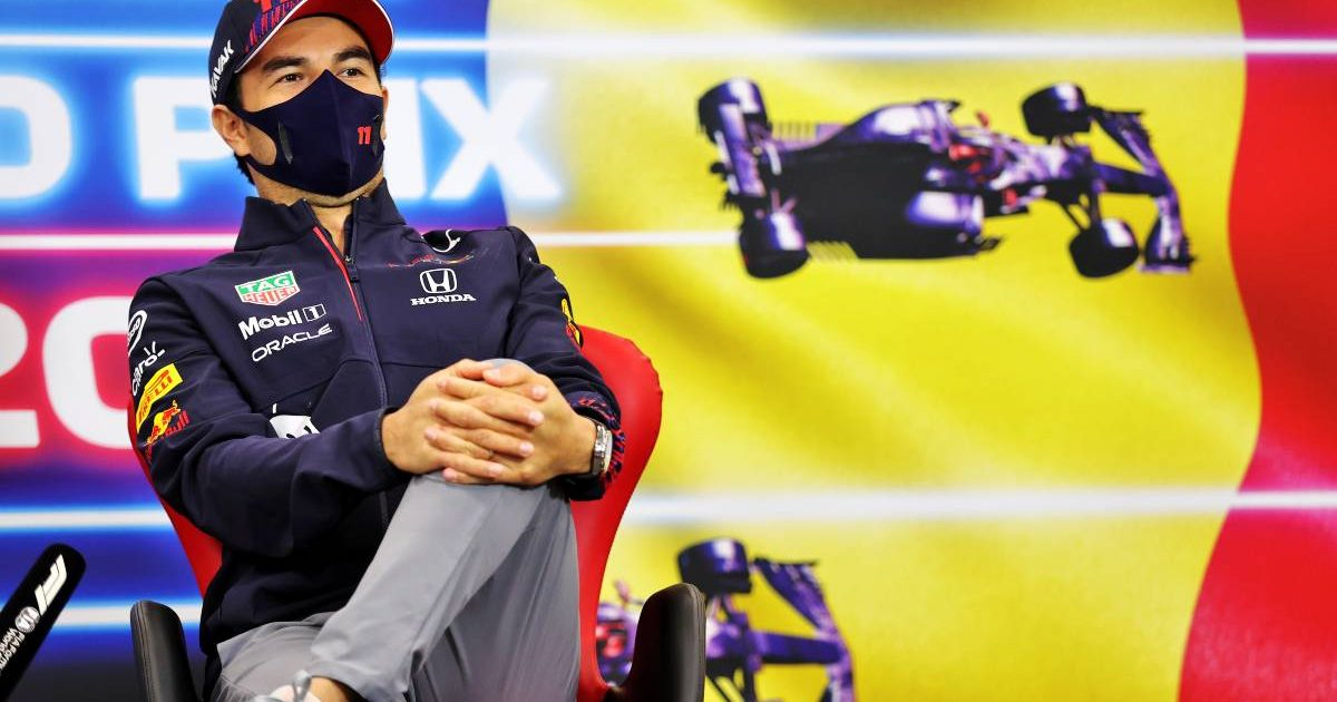 Sergio Perez [Red Bull] with his leg up in the Belgian GP press conference. August 2021.