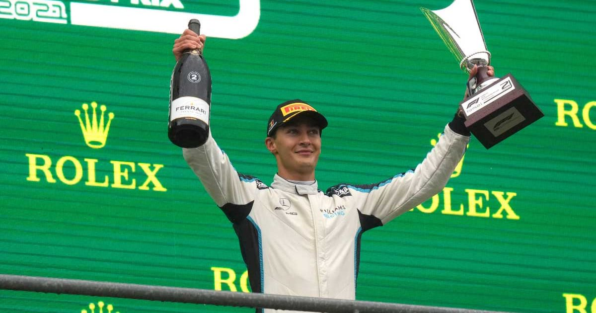 George Russell celebrates his first F1 podium