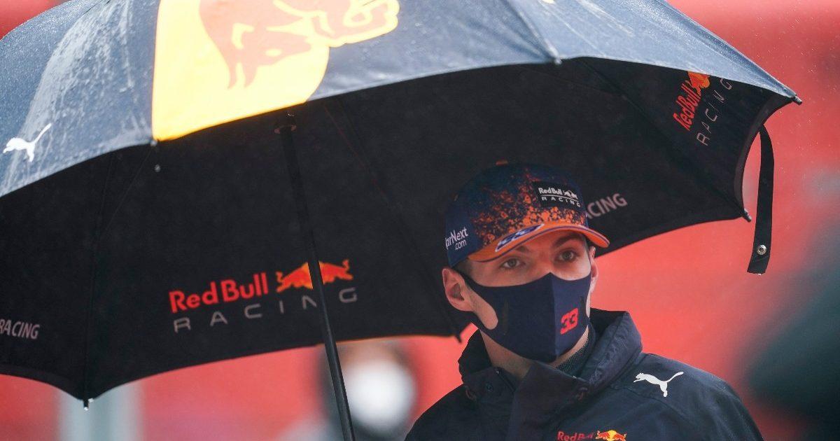 Max Verstappen holding an umbrella. Belgium August 2021