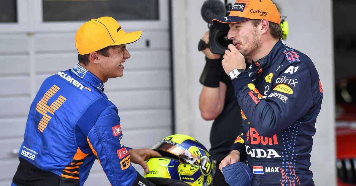Lando Norris and Max Verstappen share a joke after a race.