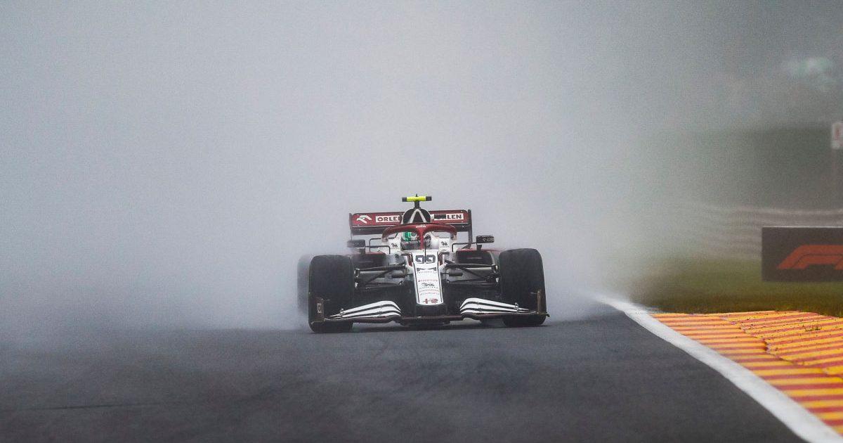 Alfa Romeo driver Antonio Giovinazzi kicks up spray on the Kemmel Straight at Spa.