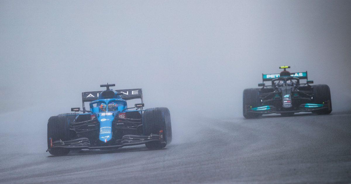 Fernando Alonso and Valtteri Bottas in the spray. Belgium, August 2021.