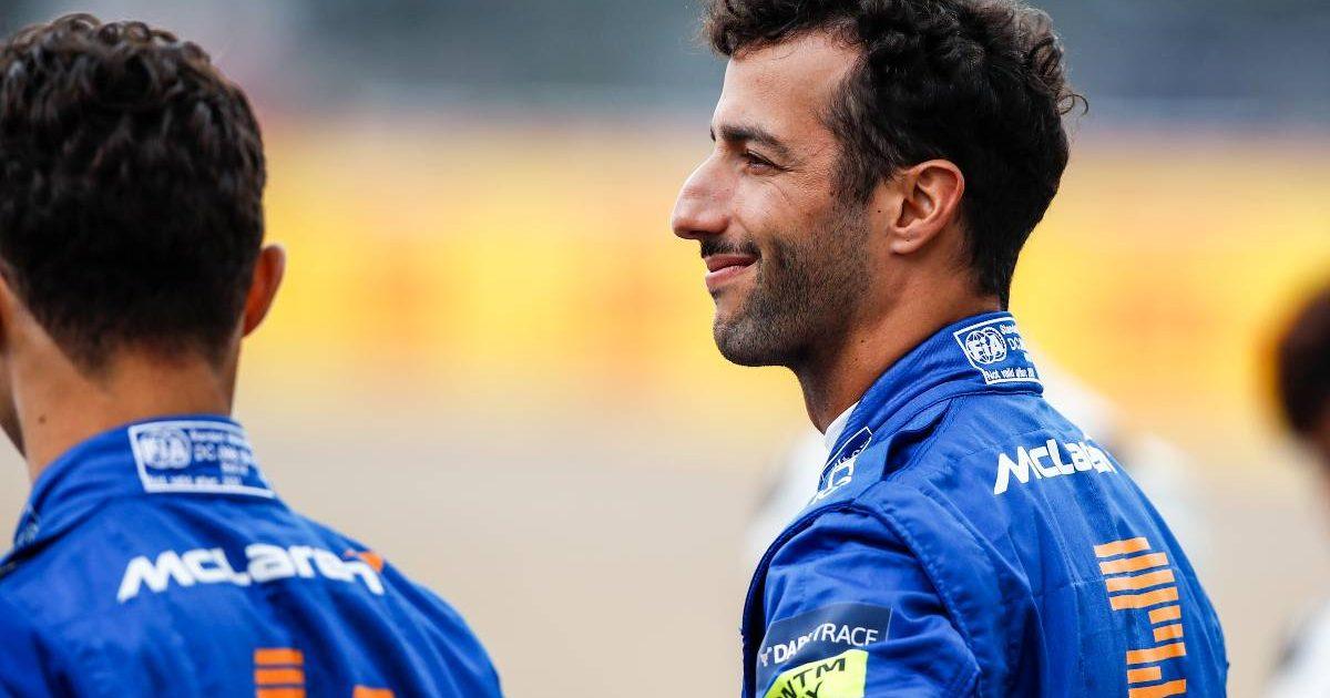Daniel Ricciardo standing next to Lando Norris. Silverstone July 2021.